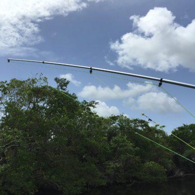 Outrigger roller guides halyard line